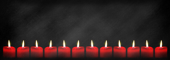 Red candles on panoramic blackboard background