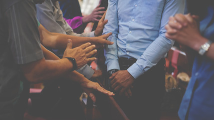 People praying together at Church.