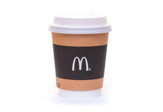 MOSCOW - NOV 03: Paper Cup with Coffee or Tea with M Brand of McDonald's in Moscow on November 03. 2019 in Russia. McDonald's Corporation is an American fast food company, founded in 1940s