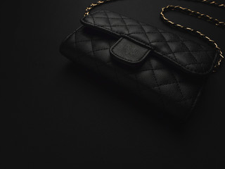 Elegance women's accessories fashion black shoulder leather bag with golden chain with copy space.