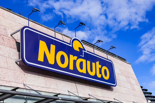 Almada, Portugal - October 24, 2019: Signboard of Norauto car or auto parts shop and service station or auto repair shop in Almada Forum shopping mall or center. Norauto is a French company