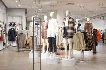 Modern fashionable brand interior of clothing store inside shopping center Wall mural