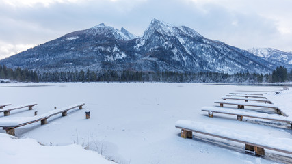 piers on partly frozen lake hintersee, ramsau, bavaria in winter