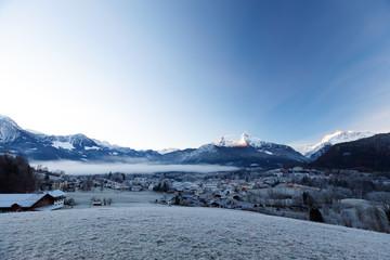 Sunrise over Berchtesgaden and Mount Watzmann in winter with frost