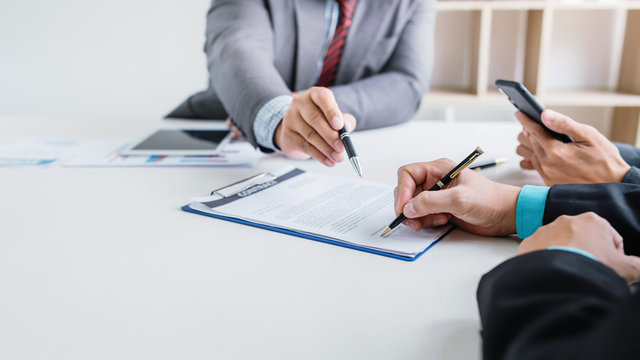 Business people sign financial business contract.