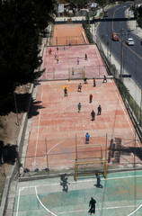 A picture taken from the Teleferico cable car shows people playing football in La Paz