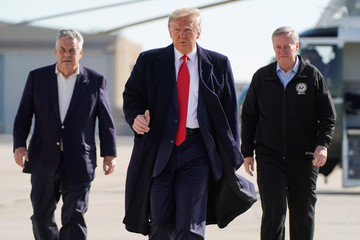 U.S. President Donald Trump boards Air Force One with Reps. Mark Meadows (R-NC) and Peter King (R-NY) as he departs from New York