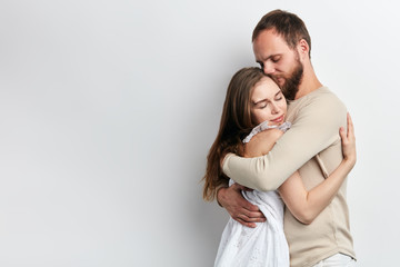 man supports his girlfriend as she has serious problems, close up photo. isolated white background, copy space, lifestyle, free time. spaare time