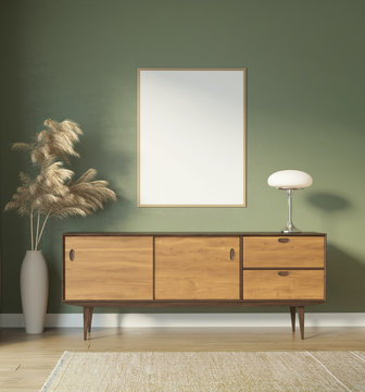 Contemporary green interior with frame and mid century buffet