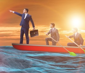 The team of businessmen in teamwork concept with boat