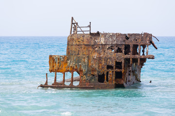 Acrylic Prints Shipwreck Rusty ruined ship wreck remainings in the middle of the sea, close to the shore of Cyprus.