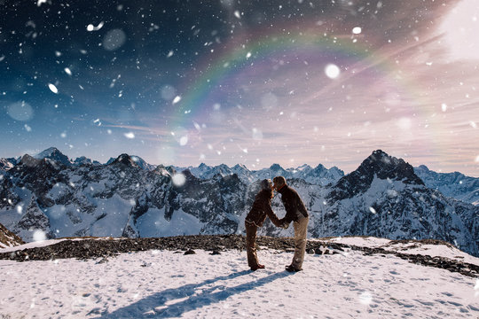 Couple hugging in the snow. Young couple in love hugging on top of a mountain. Les 2 Alpes, French Alps