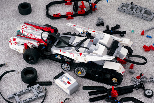 Tambov, Russian Federation - October 31, 2019 LEGO MINDSTORMS EV3 robot on room floor with some bricks and blocks.
