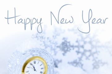 Image for New Year includes the face of a clock nearing twelve o'clock and sparkly accent pieces. Message added