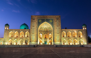 View of Registan square in Samarkand - the main square with Ulugbek madrasah at sunset. Uzbekistan
