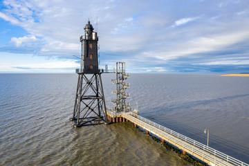 Beautiful Obereversand lighthouse (Leuchtturm) of North Sea near Bremen, Bremerhaven and Weser river. Dorum-Neufeld, Wurster Nordseeküste, Germany. Lower Saxon Wadden Sea National park
