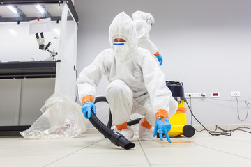Decontamination of a room after an incident. Practical exercises during a training session on asbestos risk prevention, sample preparation room of an environmental laboratory specialized in asbestos Wall mural