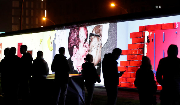 Video footage linked to the Fall of the Berlin Wall is projected during a rehearsal with 3D video beamers on the East Side Gallery in Berlin