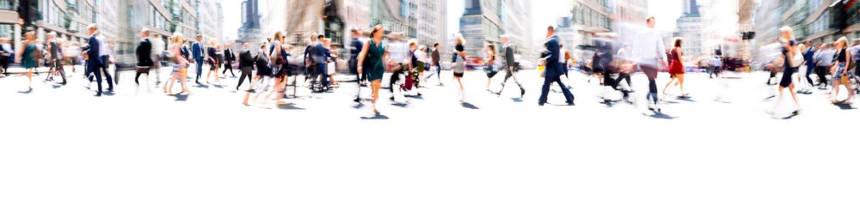 Walking people blur. Lots of people walking in the City of London. Wide panoramic view of people crossing the road.