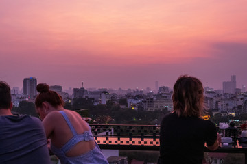 Hanoi city Skyline and cityscape captured during a beautiful Vietnamese sunset in October of 2019 from a skybar. Fototapete