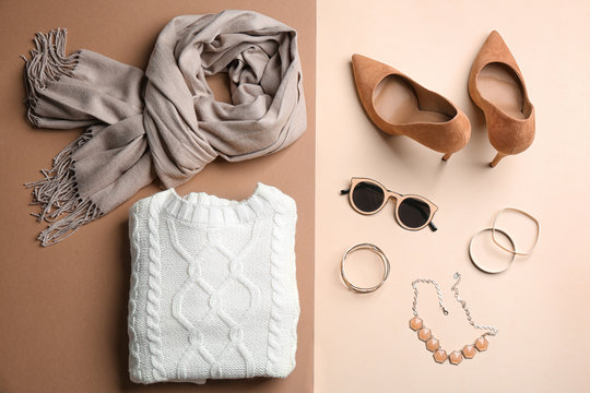 Flat lay composition with accessories and clothes on color background