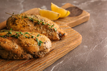 Foto op Canvas Kip Baked lemon chicken with thyme served on grey marble table. Space for text