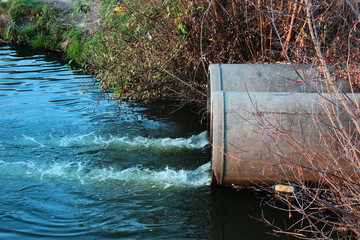 Discharge of sewage into a river