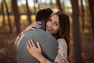 young lovers hugging each other smiling - stock Image