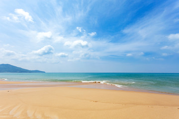 Tropical sandy beach with blue ocean and blue sky background image for nature background or summer background