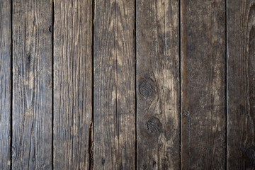 Background of wood. Old parquet. Natural scuffs and cracked. Old wooden floor. Background from natural materials. Boards. Parquet in the old house. Swirls on wooden boards. Natural texture.