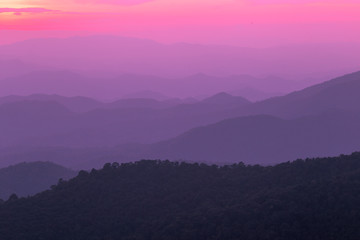 Deurstickers Candy roze The blurred natural background of colorful twilight in the evening, on the high mountains, with many forests, provide fresh air and preserve the ecology.