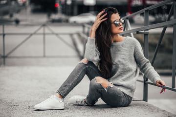 Beautiful girl posing in the street. Urban style. Street fashion. Wall mural