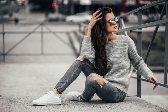 Beautiful girl posing in the street. Urban style. Street fashion.