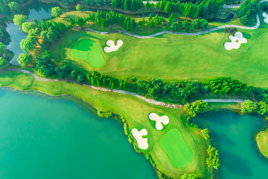 Aerial view of golf course and water