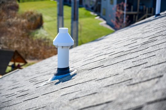 PVC chimney exhaust with boot on  asphalt roof