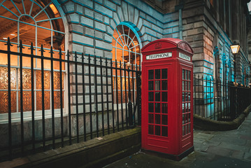 Traditional and iconic old red telephone box in London UK.