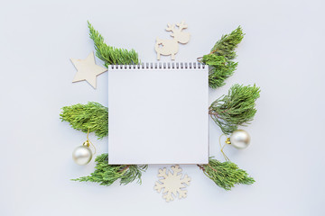 Christmas composition with paper blank, fir branches on white. new year concept. Greeting card,...
