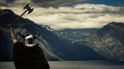 Viking warrior on fjord shore, Norway
