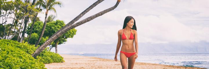 Wall Mural - Beach beautiful fit Asian bikini girl walking relaxing on Maui island beach vacation destination ,Hawaii, USA. Panoramic banner young people summer travel lifestyle.