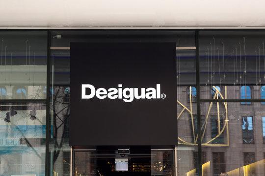 Desigual logo logotype shop signage
