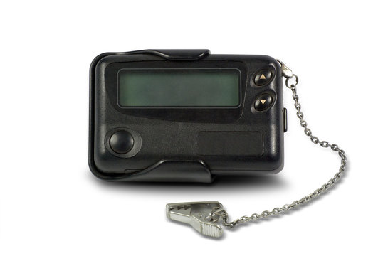 Close-up old a black pager or beeper isolated with clipping path on white background.