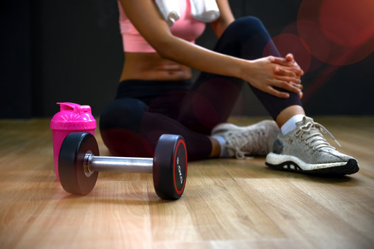 Steel dumbbell stay along with healthy woman, being for exercise for less weight and strong body