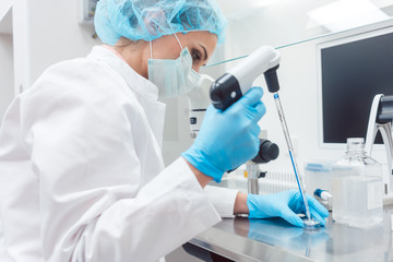 Scientist in lab conducting biotechnological experiment