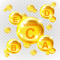 Vector realistic vitamin golden capsules. Nutrition supplement multivitamin complex. Golden round capsules isolated on transparent background.