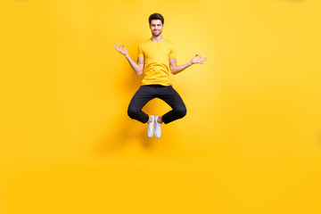 Full body photo of handsome guy jumping high lotus position morning yoga training relaxing fingers...