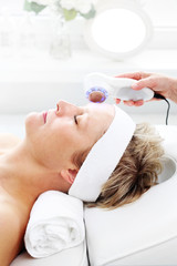 Photonic ultrasonic facial massage. Ultrasonic facial massage using light therapy. Professional...
