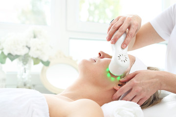 Ultrasonic facial massage, light phototherapy. Ultrasonic facial massage using light therapy....