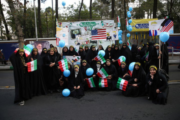 Iranian students pose for a photo, as they attend an anti U.S. demonstration, marking the 40th anniversary of the U.S. embassy takeover,  near the old U.S. embassy in Tehran