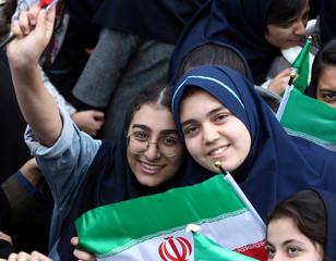 Iranian students pose for a photo as they attend an anti U.S. demonstration, marking the 40th anniversary of the U.S. embassy takeover, near the old U.S. embassy in Tehran