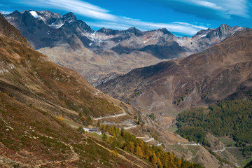 Timmelsjoch alpine street winding down the mountain along the Obere Glanegg Alm in the Italian Alps